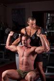 Bodybuilders exercising — Stock Photo