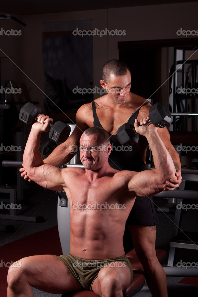 Bodybuilders exercising in a gym together  Stock Photo #6888415