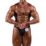 Bodybuilder flexing — Stock Photo