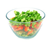 A bowl of salad with fresh lettuce, cucumber and tomato — Stock Photo