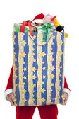 Santa claus met cadeau — Stockfoto