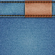Vector de stock : Denim texture with leather label