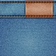 ストックベクタ: Denim texture with leather label