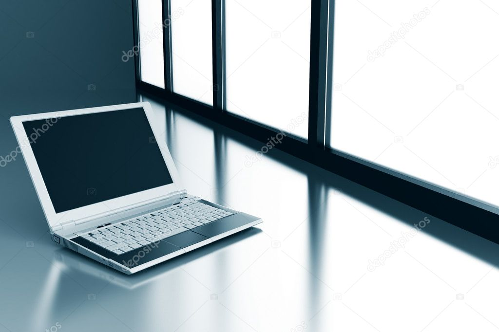 Laptop on a smooth surface and light from a window  Stock Photo #6867879