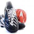 Sports footwear and red soccer ball — Stock Photo #7152032