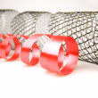 Red and mesh decorative ribbons — Stock Photo