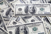 Chaotically lyings one hundred greenbacks — Stock Photo