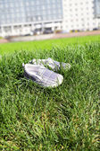 Children's footwear on a green grass — Stock Photo
