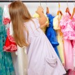 Little girl in shop of dresses — Stock Photo #6955183