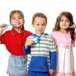 Royalty-Free Stock Photo: Children with tooth-brushes. Isolated on white