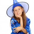 Young witch with a magic wand isolated on the white — Stock Photo #6955193