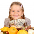 Little girl counts money and vegetables isolated on the white — Stock Photo #6955199