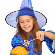 Young witch with a magic wand and pumpkin isolated on the white — Stock Photo #6955201