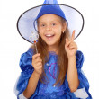 Young witch with a magic wand isolated on the white — Stock Photo