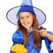 Young witch with a magic wand and pumpkin isolated on the white — Stock Photo