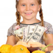 Stock Photo: Little girl counts money and vegetables isolated on white