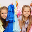 Little girls in shop of dresses — Stock Photo #6955213