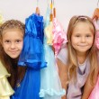 Little girls in shop of dresses — Stock Photo