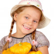Llittle girl with bush pumpkins. Isolated over white — Stock Photo #6955217