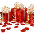 Three red gift box and hearts isolated on white background — Stock Photo