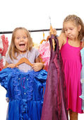 Little girls in shop of dresses. Isolated on white — Stock Photo
