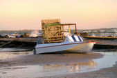 The broken tower rescuer and boat on seacoast after a storm at s — Stock Photo