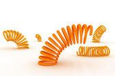 Resortes naranjas sobre un fondo blanco — Foto de Stock