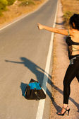 Sexy hitchhiker — Stock Photo