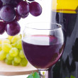 Royalty-Free Stock Photo: Red wine and grapes