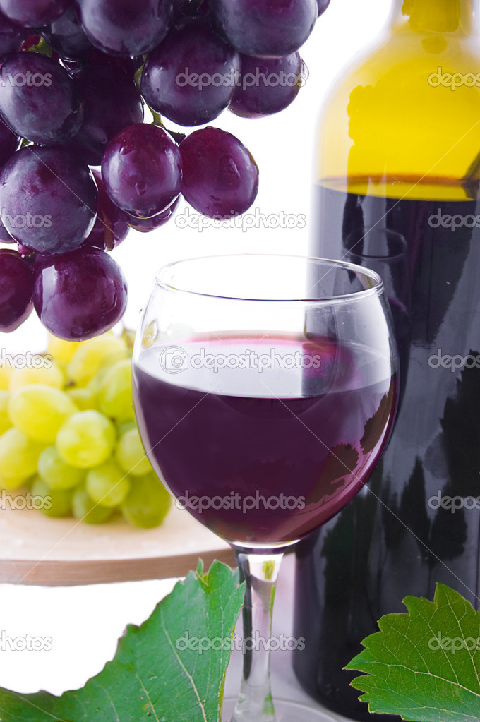 Red wine bottle, glass and cask with grapes over white — Stock Photo #6835281