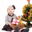 Little girl with Christmas tree and gifts — 图库照片
