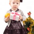 Little girl with Christmas tree and gifts — Stock Photo