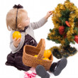 Stock Photo: Little girl with Christmas tree