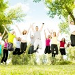 Large group of teens jumping together — Stock Photo #6835282