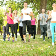 Large group jogging in park — Stock Photo