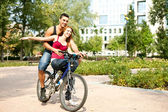 Young couple on bicycle — Stock Photo