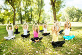 Group of doing yoga outdoor — Stock Photo