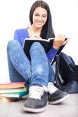 Veselý studentský dělat domácí úkoly — Stock fotografie