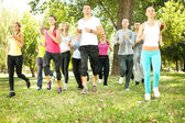 Large group jogging in park — Photo
