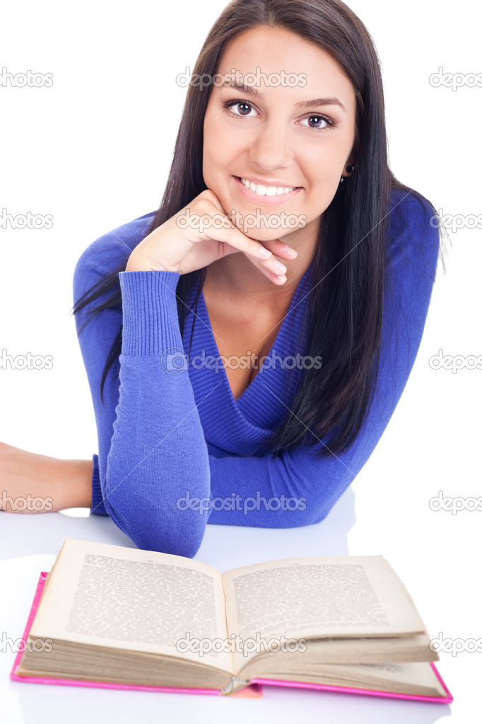Portrait of cute girl with open book and looking at camera — Stock Photo #6836170
