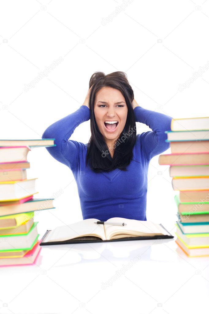 Crazy student girl screaming, between stack of book, isolated on white — Stock Photo #6836356
