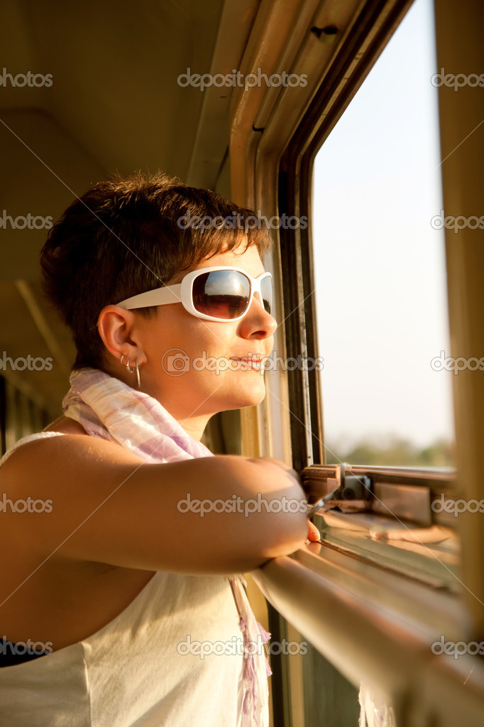 Woman looking out the window — Stock Photo #6837477