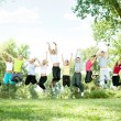 Young jumping in park — Stock Photo