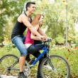 Young couple on bike - Stock Photo