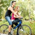 Young couple on bike — Stock Photo