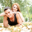 Happy young couple together in park — Stock Photo