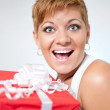 Surprised girl holding present — Stock Photo #6916235