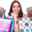 Woman shoving her shopping bags — Stock Photo #6916374