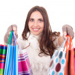 Woman shoving her shopping bags — Stock Photo #6916376