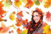 Autumn woman holding cone — Stock Photo